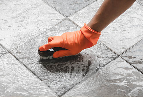 Photo of floor tiles being cleaned